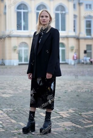 Stock Image of Actress Mavie Hoerbiger poses for the media in front of the Charlottenburg palace during the red carpet for the tv series 'Ich und die Anderen' (Me and the others) as part of the 'Berlinale Summer Special' film festival in Berlin, Germany