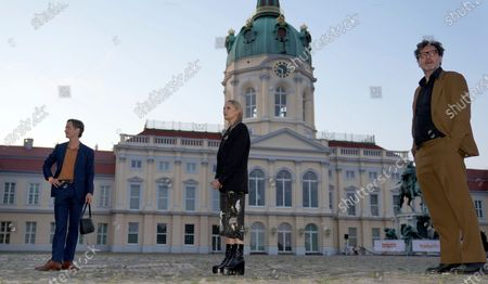 Stock Photo of From left, actor Tom Schilling, actress Mavie Hoerbiger and director David Schalko pose for the media in front of the Charlottenburg palace during the red carpet for the tv series 'Ich und die Anderen' (Me and the others) as part of the 'Berlinale Summer Special' film festival in Berlin, Germany