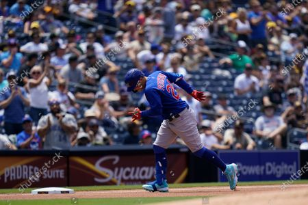 Chicago Cubs' Joc Pederson pauses as he rounds third base after hitting a home run during the fourth inning of a baseball game against the San Diego Padres, in San Diego