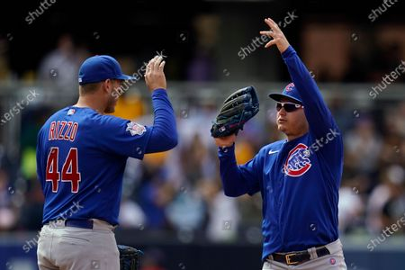 Chicago Cubs first baseman Anthony Rizzo (44) celebrates with left fielder Joc Pederson after the Cubs defeated the San Diego Padres 3-1 in a baseball game, in San Diego