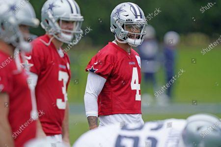 Dallas Cowboys quarterback Dak Prescott (4) lines up with quarterbacks Garrett Gilbert (3) and Ben DiNucci (7) during an NFL football team practice, in Frisco, Texas