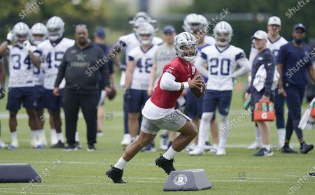 Stock Photo of Dallas Cowboys quarterback Dak Prescott (4) runs a drill in front of teammates during an NFL football team practice, in Frisco, Texas