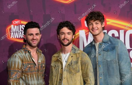 Colton Pack, from left, Garrett Nichols, and Zach Beeken of Restless Road arrive at the CMT Music Awards at the Bridgestone Arena, in Nashville, Tenn