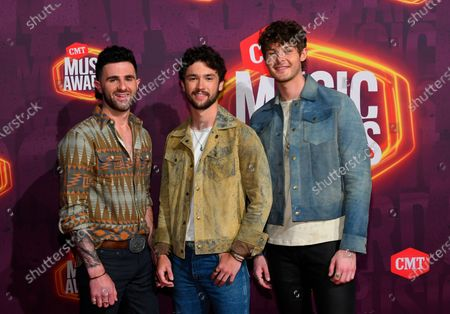 Stock Picture of Colton Pack, from left, Garrett Nichols, and Zach Beeken of Restless Road arrive at the CMT Music Awards at the Bridgestone Arena, in Nashville, Tenn