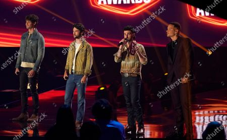 Stock Photo of Zach Beeken, from left, Garrett Nichols and Colton Pack of Restless Road, and Kane Brown present the award for CMT performance of the year at the CMT Music Awards at the Bridgestone Arena, in Nashville, Tenn