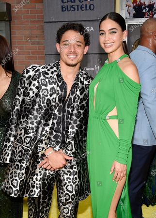 """Actors Anthony Ramos, left, and Melissa Barrera pose together at the 2021 Tribeca Film Festival opening night premiere of """"In The Heights"""" at the United Palace theater, in New York"""