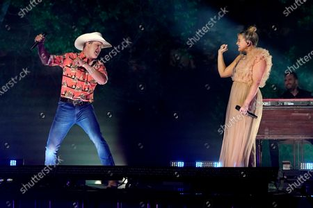 """Stock Image of Jon Pardi, left, and Lauren Alaina perform """"Getting Over Him"""" at the CMT Music Awards, in Franklin, Tenn. The awards show airs on June 9 with both live and prerecorded segments"""