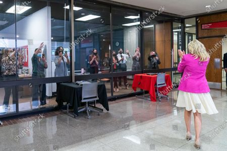 First Lady Jill Biden waves to onlookers as she arrives at Sauk Valley Community College in Dixon, Illinois on April 19, 2021. (Official White House Photo by Cameron Smith)