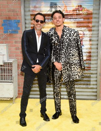 """Actor-singers Marc Anthony, left, and Anthony Ramos pose together at the 2021 Tribeca Film Festival opening night premiere of """"In The Heights"""" at the United Palace theater, in New York"""