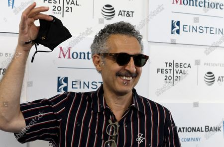 John Turturro holds up his protective face mask at the Opening Night Premiere of the film 'In The Heights' during the 2021 Tribeca Film Festival at The Battery, in New York, New York, USA, 09 June 2021.
