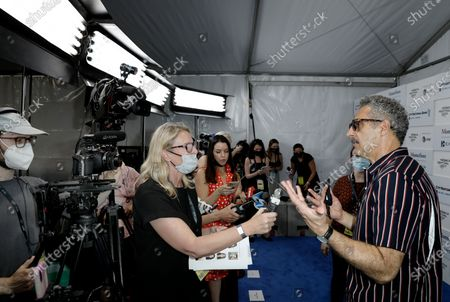 John Turturro (R) speaks with the media at the Opening Night Premiere of the film 'In The Heights' during the 2021 Tribeca Film Festival at The Battery, in New York, New York, USA, 09 June 2021.