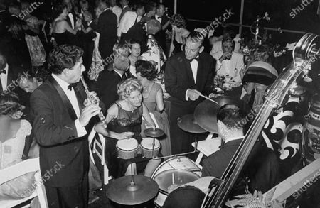 Woman musician, Hoagy Carmichael at Hollywood party.