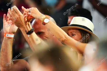 Novak Djokovic's wife, Jelena Djokovic celebrates his victory by making a heart sign with her hands