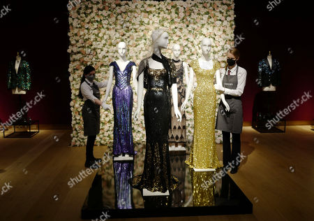 'Oscar' dress worn by Nicole Kidman, with dresses worn by Penelope Cruz and Daphne Guinness in the background during the L'Wren Scott dress sale