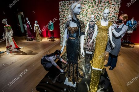 A black and gold sequined 'OSCAR' dress worn by Nicole Kidman, est £1,500-2,500 with dresses worn by Penelope Cruz and Daphne Guinness in the background - 55 lots from the archive of fashion designer L'Wren Scott. Being sold to celebrate L'Wren Scott's legacy, with the proceeds being donated to further fund the L'Wren Scott Scholarship at Central St. Martins which was set up by Mick Jagger In 2015. Previewed at Christies King Street, London.