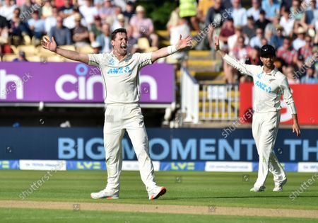 New Zealand's Matt Henry, left, appeals unsuccessfully for the wicket of England's Mark Wood during the first day of the second cricket test match between England and New Zealand at Edgbaston in Birmingham, England