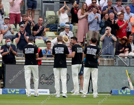 Jimmy Anderson (2nd right) is applauded off the pitch after the moment of unity as he breaks the England Test appearance record