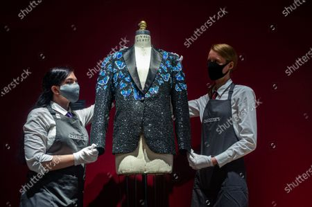 A butterfly themed jacket made for Mick Jagger at the L'Wren Scott Collection photocall at Christie's Auction Housen to celebrate L'Wren Scott' legacy with the proceeds being donated to further fund the L'Wren Scott Scholarship at Central St. Martins set up by Mick Jagger in 2015
