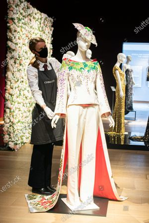 A couture embroidered kimono tailcoat ensemble by L'Wren Scott at the L'Wren Scott Collection photocall at Christie's Auction House  to celebrate L'Wren Scott' legacy with the proceeds being donated to further fund the L'Wren Scott Scholarship at Central St. Martins set up by Mick Jagger in 2015