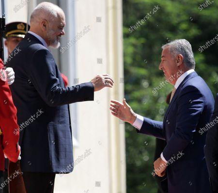 Stock Photo of Prime Minister of Albania Edi Rama (L) welcomes the President of Montenegro Milo Djukanovic (R) at the Western Balkan summit in Tirana, Albania, 10 June 2021.