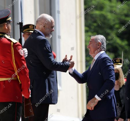 Prime Minister of Albania Edi Rama (L) welcomes the President of Montenegro Milo Djukanovic (R) at the Western Balkan summit in Tirana, Albania, 10 June 2021.