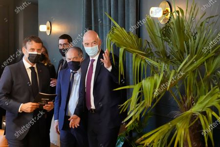 French President Emmanuel Macron, left, meets FIFA president Gianni Infantino, right, and French Football Federation (FFF) president Noel Le Graet, center, during the inauguration of the Hotel de La Marine Museum, in Paris, . The building, located at Concorde square in Paris, designed by French architect Ange-Jacques Gabriel, hosted the Marine Headquarters from 1789 until 2015