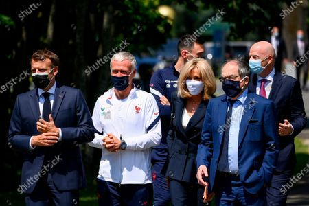 French President Emmanuel Macron, left, France's coach Didier Deschamps, France's goalkeeper Hugo Lloris, French President's wife wife Brigitte Macron, French Football Federation (FFF) president Noel Le Graet, second right, and FIFA president Gianni Infantino, right, arrive at the national soccer training camp in Clairefontaine-en-Yvelines, ahead of the UEFA EURO 2020 soccer tournament