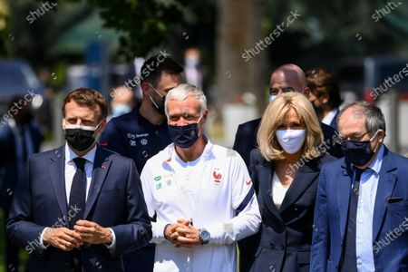 French President Emmanuel Macron, left, France's coach Didier Deschamps, France's goalkeeper Hugo Lloris, French President's wife wife Brigitte Macron, French Football Federation (FFF) president Noel Le Graet, right, and FIFA president Gianni Infantino, second row right, arrive at the national soccer training camp in Clairefontaine-en-Yvelines, ahead of the UEFA EURO 2020 soccer tournament