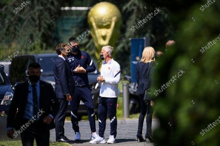 French President Emmanuel Macron, left, speaks with France's goalkeeper Hugo Lloris center, and France's coach Didier Deschamps as he arrives at the national soccer training camp in Clairefontaine-en-Yvelines, ahead of the UEFA EURO 2020 soccer tournament
