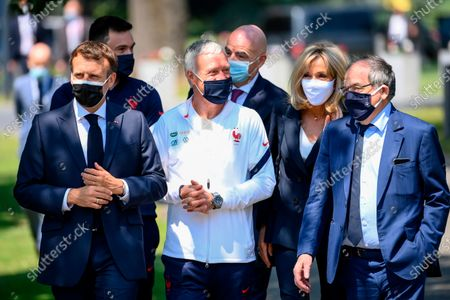 French President Emmanuel Macron, left, France's coach Didier Deschamps, France's goalkeeper Hugo Lloris, behind left, French President's wife Brigitte Macron, French Football Federation (FFF) president Noel Le Graet, right, and FIFA president Gianni Infantino, center behind, arrive at the national soccer training camp in Clairefontaine-en-Yvelines, ahead of the UEFA EURO 2020 soccer tournament