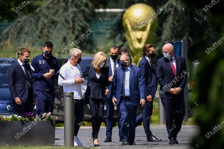 (L-R) French President Emmanuel Macron, France's goalkeeper Hugo Lloris, France's coach Didier Deschamps, French President's wife Brigitte Macron, French Football Federation (FFF) president Noel Le Graet and FIFA president Gianni Infantino arrive for a lunch with France's players in Clairefontaine-en-Yvelines, France, 10 June 2021, ahead of the UEFA EURO 2020 soccer competition.