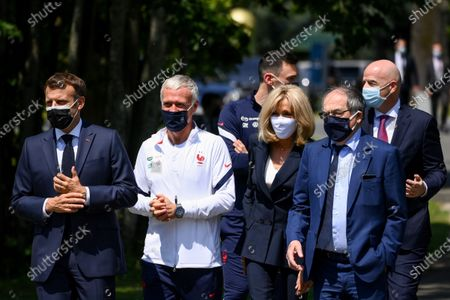 (L-R) French President Emmanuel Macron, France's coach Didier Deschamps, France's goalkeeper Hugo Lloris, French President's wife wife Brigitte Macron, French Football Federation (FFF) president Noel Le Graet and FIFA president Gianni Infantino arrive for a lunch with France's players in Clairefontaine-en-Yvelines, France, 10 June 2021, ahead of the UEFA EURO 2020 football competition.