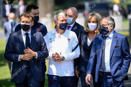 (L-R) French President Emmanuel Macron, France's goalkeeper Hugo Lloris, France's coach Didier Deschamps, FIFA president Gianni Infantino, French President's wife Brigitte Macron and French Football Federation (FFF) president Noel Le Graet arrive for a lunch with France's players in Clairefontaine-en-Yvelines, France, 10 June 2021, ahead of the UEFA EURO 2020 soccer competition.