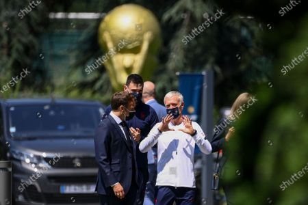 French President Emmanuel Macron (L) speaks with France's goalkeeper Hugo Lloris (C) and France's coach Didier Deschamps as he arrives for a lunch with France's players in Clairefontaine-en-Yvelines, France, 10 June 2021, ahead of the UEFA EURO 2020 soccer competition.