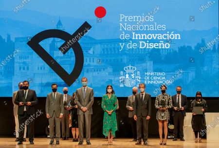 Spanish King Felipe VI (C-L) and Queen Letizia (C-R) and Andalusia regional president Juanma Moreno (2L) and Science minister Pedro Duque (2R) pose with the winners of the National Awards to Innovation and Desing in Granada, Spain, 10 June 2021.
