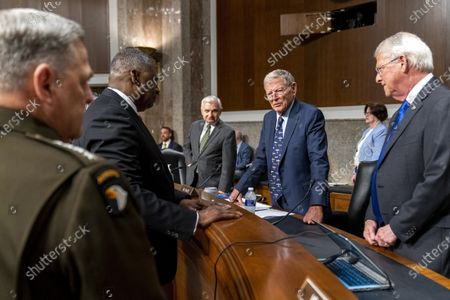From left, Chairman of the Joint Chiefs of Staff Gen. Mark Milley, Secretary of Defense Lloyd Austin, Chairman, Jack Reed, D-R.I., Ranking Member Sen. James Inhofe, R-Okla., and Sen. Roger Wicker, R-Miss., speak before a Senate Armed Services budget hearing on Capitol Hill in Washington