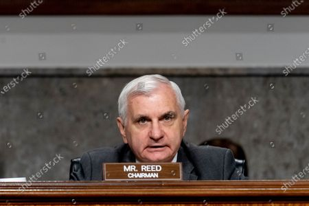 Chairman Sen. Jack Reed, D-R.I., speaks as Secretary of Defense Lloyd Austin, Chairman of the Joint Chiefs of Staff Gen. Mark Milley, and Defense Under Secretary Mike McCord appear at a Senate Armed Services budget hearing on Capitol Hill in Washington