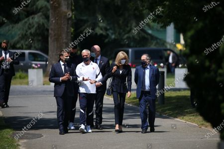 French President Emmanuel Macron, left, France's coach Didier Deschamps, France's goalkeeper Hugo Lloris, French President's wife Brigitte Macron, French Football Federation (FFF) president Noel Le Graet, second right, and FIFA president Gianni Infantino, right, arrive at the national soccer training camp in Clairefontaine-en-Yvelines, Thursday June 10, 2021 ahead of the UEFA EURO 2020 soccer tournament.