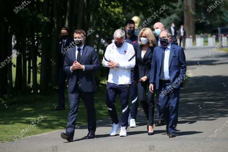 Stock Picture of French President Emmanuel Macron, left, France's coach Didier Deschamps, France's goalkeeper Hugo Lloris, French President's wife Brigitte Macron, French Football Federation (FFF) president Noel Le Graet, second right, and FIFA president Gianni Infantino, right, arrive at the national soccer training camp in Clairefontaine-en-Yvelines, Thursday June 10, 2021 ahead of the UEFA EURO 2020 soccer tournament.