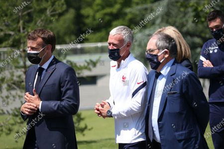 Stock Image of French President Emmanuel Macron, left, France's coach Didier Deschamps, France's goalkeeper Hugo Lloris, French President's wife wife Brigitte Macron, French Football Federation (FFF) president Noel Le Graet arrives at the national soccer training camp in ClaireFontaine-en-Yvelines, Thursday June 10, 2021 ahead of the UEFA EURO 2020 soccer tournament.