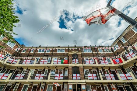 Football-mad residents in Bermondsey's Kirby Estate in south-east London have put up around 400 England (cross of St George) flags ahead of the European Championship which starts this weekend and is in fact the Covid-delayed 2020 tournament.