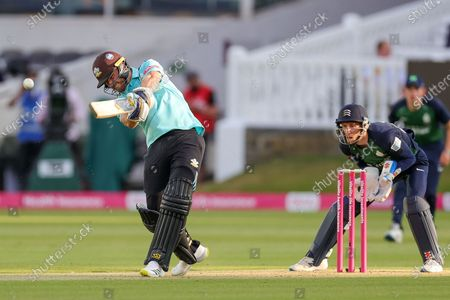 Stock Picture of Laurie Evans of Surrey hits the ball and is caught by Luke Hollman of Middlesex during the Vitality T20 Blast South Group match between Middlesex County Cricket Club and Surrey County Cricket Club at Lord's Cricket Ground, St John's Wood