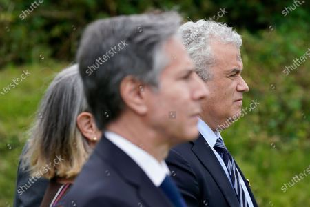 Secretary of State Antony Blinken, front, and Jeff Zients, White House coronavirus response coordinator, right, listen as President Joe Biden speaks about his administration's global COVID-19 vaccination efforts ahead of the G-7 summit, in St. Ives, England