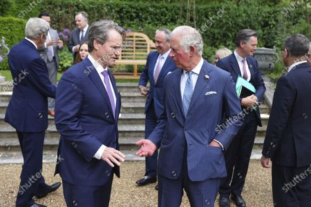 Of Bank of America, Brian Moynihan, left, speaks with Britain's Prince Charles, during a sustainability and G7 engagement event for Terra Carta Transition Coalitions, an organized, global collective working together to drive investment towards a sustainable future for Nature, People and Planet, at St James's Palace in London