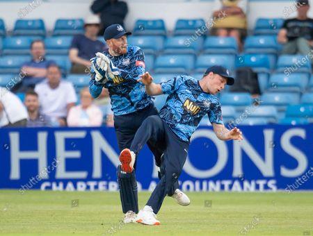 Yorkshire's Jonny Bairstow & Matthew Waite clash as Bairstow takes a catch to dismiss Birmingham's Tim Bresnan.
