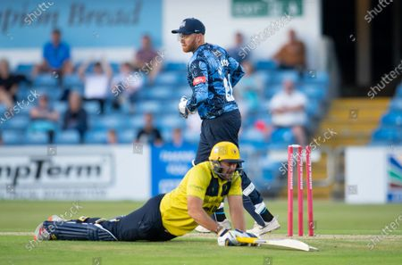 Stock Photo of Yorkshire's Jonny Bairstow attempts a run out of Birmingham's Tim Bresnan.