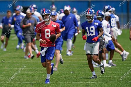 New York Giants quarterback Daniel Jones (8) and wide receiver Kenny Golladay (19) make their way down the field during an NFL football practice, in East Rutherford, N.J