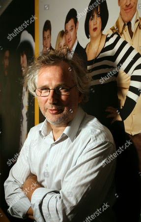 Stock Photo of Henry Normal in front of a Gavin and Stacey billboard at his office