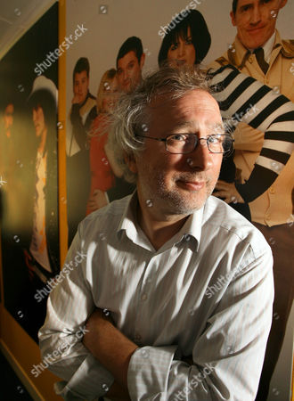 Henry Normal, comedian, writer and Managing Director of Baby Cow Productions, pictured in front of a Gavin and Stacey billboard at his office in London, July 6th 2010. Credit: Susannah Ireland
