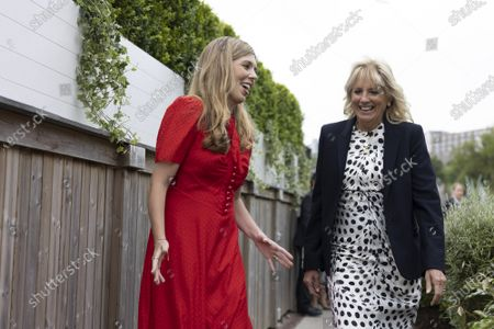 Stock Image of Carrie Johnson, the wife of Prime Minister Boris Johnson, speaks with First Lady of the United States Dr. Jill Biden ahead of the G7 Leaders' Summit in Carbis Bay, Cornwall, United Kingdom, on June 10, 2021.